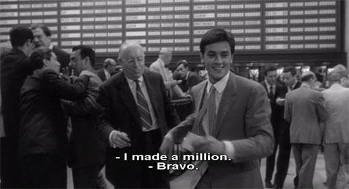 Piero (Alain Delon) doet in L'eclisse (1962) goede zaken op de beursvloer van Rome.